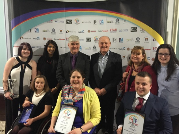 Dragons Picking Up Their Dundee Community Spirit Award. Back L-R: Jay O'Reilly, Farana Latif, Kevin Rattray, Bill Lamb, Sally Lumsdaine, Jen Scally. Front L-R: Gemma Lumsdaine, Elizabeth Ferris, Stephen Carling.