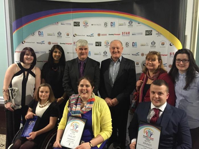 Dragons Picking Up Their Dundee Community Spirit Award. Back L-R: Jay O'Reilly, Farana Latif, Kevin Rattray, Bill Lamb, Sally Lumsdaine, Jen Scally. Front L-R: Gemma Lumsdaine, Elizabeth Ferris, Stephen Carling.